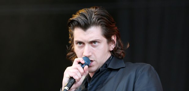Alex Turner performing 2016